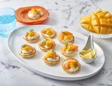 Smoked salmon and mango blinis